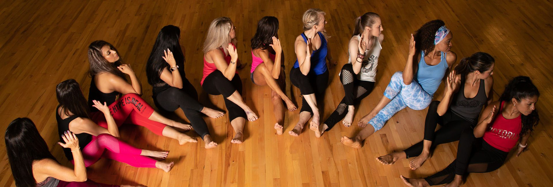 Group Yoga/Pilates class stretching