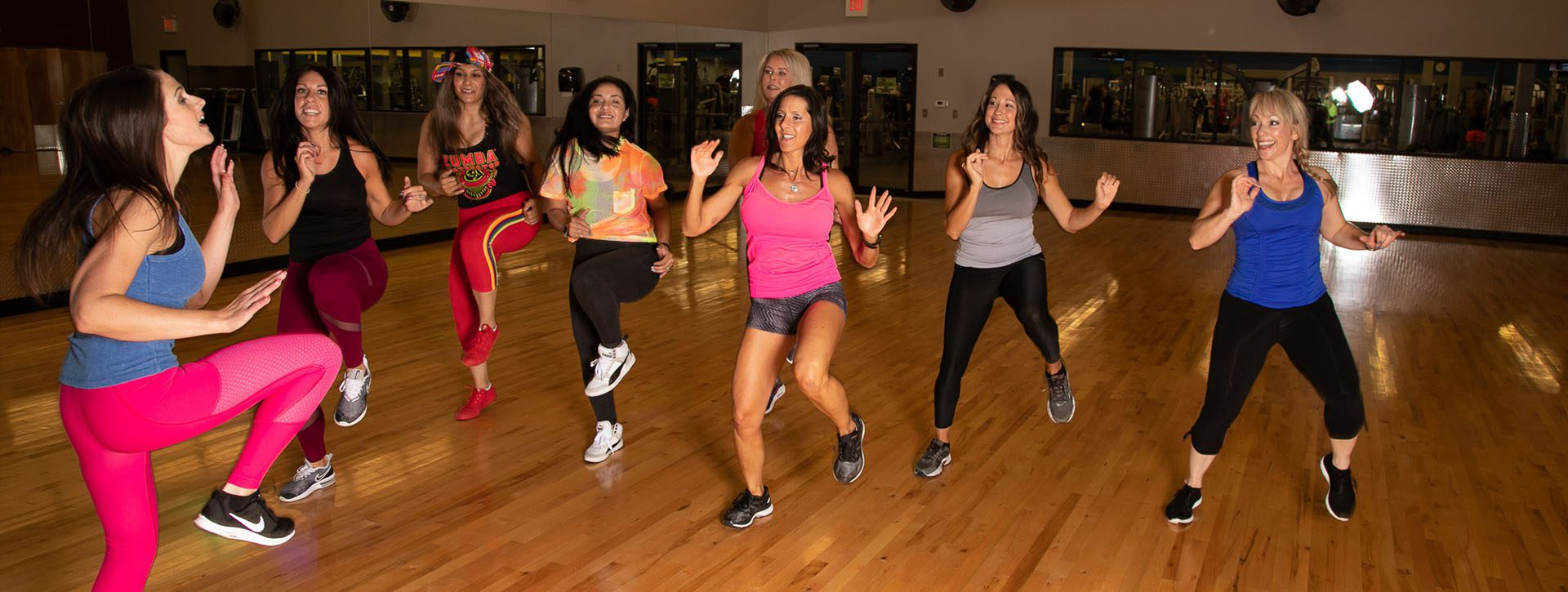 Group fitness class doing zumba.