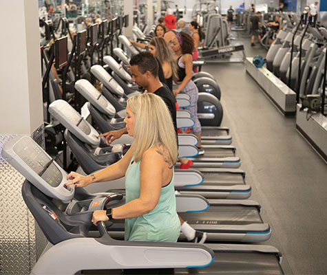 gym members using cardio machines
