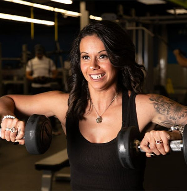 woman lifting weights at best oklahoma gym near me
