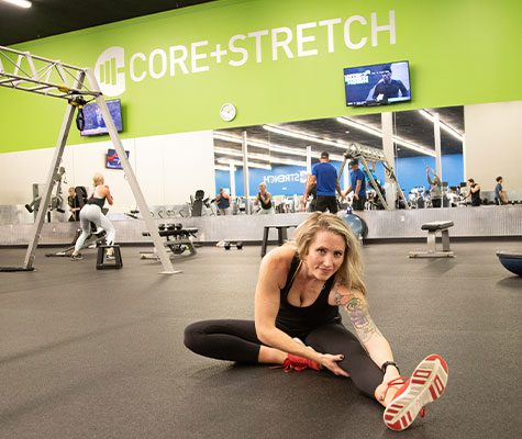 Woman stretching in designated stretching area